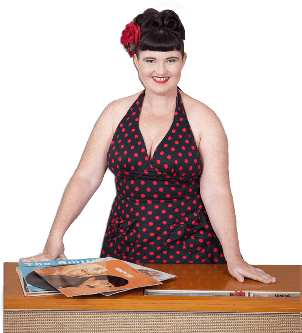 Eilis Hughes, otherwise known as DJ Oily Shoes, with a 1950s record player and some records